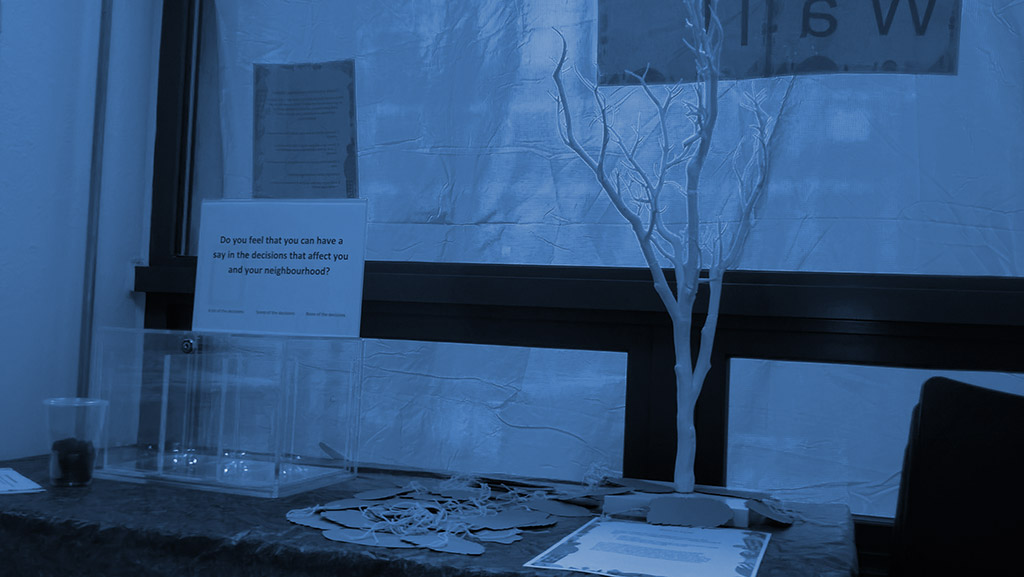 noticeboard and desk with leafless tree on the table